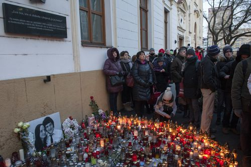 Hundreds of people gathered in the centre of Bratislava, Slovakia, February 28, 2018, carrying burning candles in commemoration of journalist Jan Kuciak and his girlfriend, who were murdered last week. The rally set off from the central SNP Square to the government seat. Further commemorative meetings are to take place in towns across Slovakia on Friday and Saturday, organised by civic activists. Photo/Martin Mikula (CTK via AP Images)