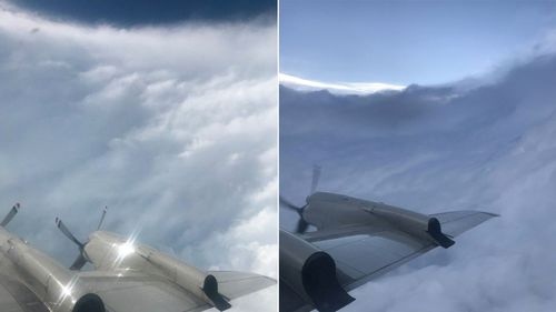 Photograph captures the wing and propeller of a US Air Force plane flying in and around Hurricane Dorian. The 'stadium effect' is evident.