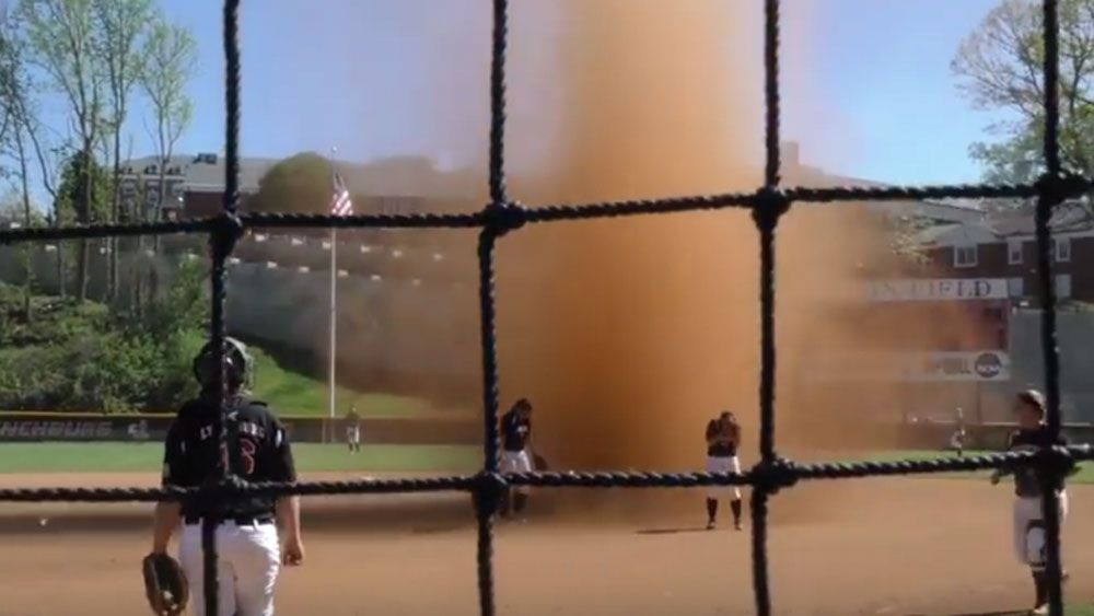 'Dust devil' interupts softball game
