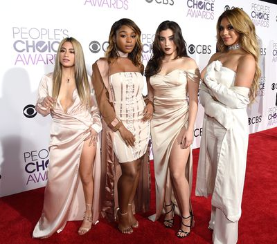<p>A match made in heaven. Blush outfits suited all four members of Fifth Harmony. The group performed live during the show.</p> <p>Image: Getty.</p>