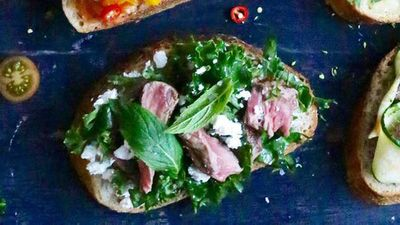 Open steak sandwich with feta, mint and kale