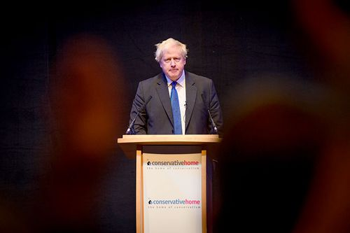 Boris Johnson presents at the Conservative Party conference in Birmingham.
