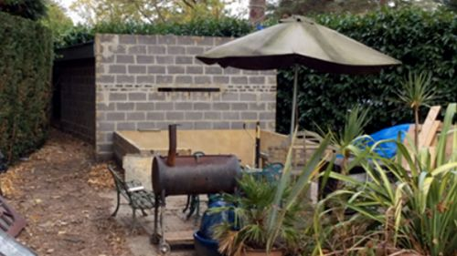 The stark concrete shed in a suburban English garden where the Polish man lived for four years.