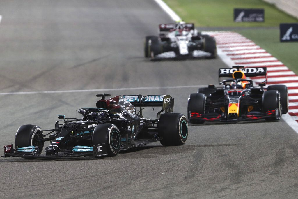 Mercedes driver Lewis Hamilton of Britain steers his car followed by Red Bull driver Max Verstappen of the Netherlands during the Bahrain Formula One Grand Prix at the Bahrain International Circuit in Sakhir.