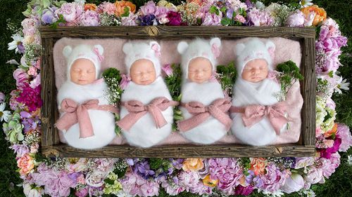 Sleeping quadruplet sisters look like Cabbage Patch dolls