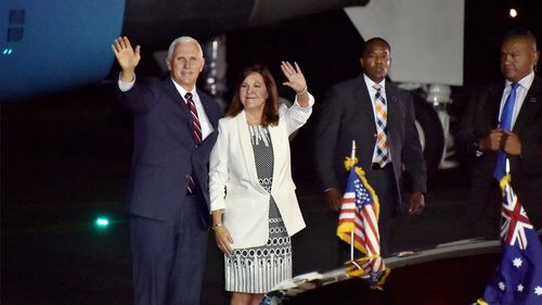 United States Vice President Mike Pence and his wife Karen wave as they arrive in Cairns, Australia.