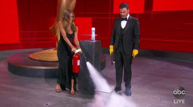 Jimmy Kimmel and Jennifer Aniston sanitise Emmys envelope.