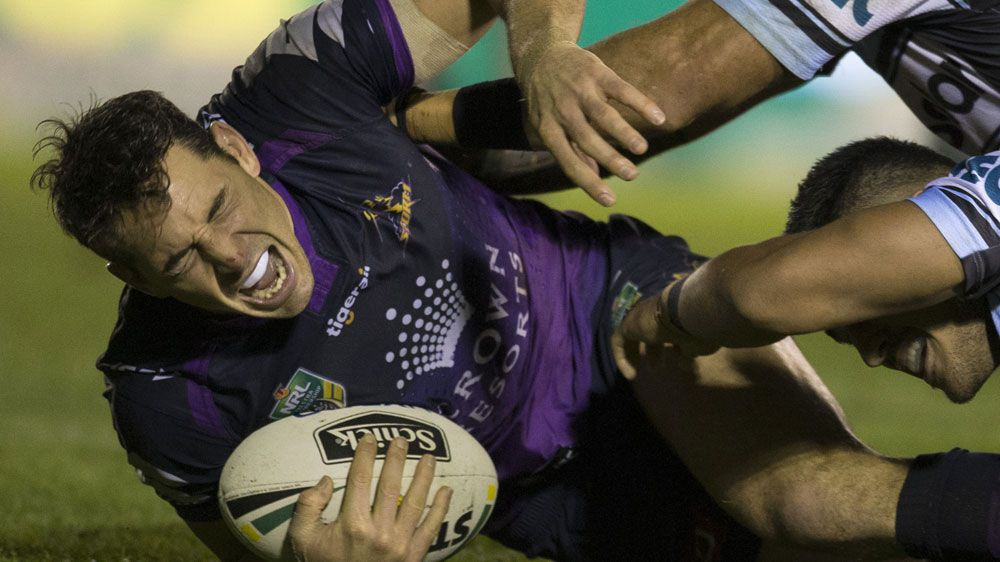Billy Slater suffers injury scare in close win over Cronulla Sharks
