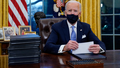 President Joe Biden pauses as he signs his first executive orders in the Oval Office of the White House on Wednesday, Jan. 20, 2021, in Washington. (AP Photo/Evan Vucci)