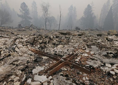 A cross is among the rubble of the Our Savior Lutheran Church in Paradise.