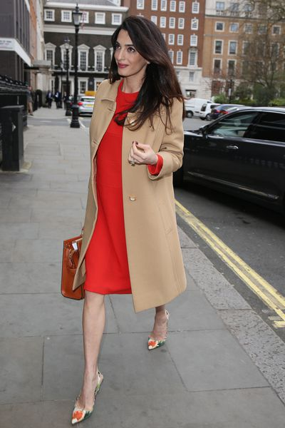 Amal Clooney - all-round excellent human being, human rights lawyer and ultra-chic pregnant woman loves a trench-coat and who can blame her.
