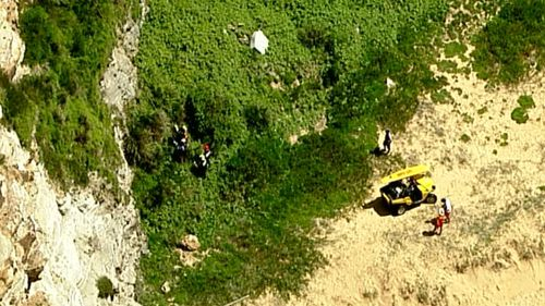 She was safely brought to the base of the cliff. (9NEWS)