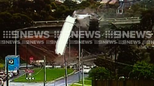 Another exclusive video obtained by 9News shows the moment a truck launched over an entry ramp in Melbourne's north-west yesterday.