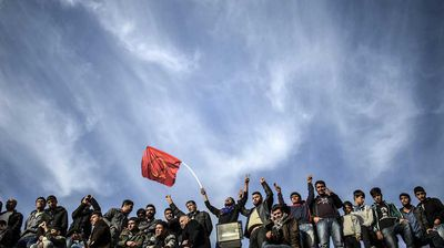 Kurds, who are predominantly Sunni like their Islamic State enemy, celebrate near the Turkish-Syrian border.