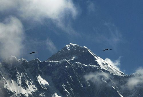 Birds glie in the Himalayas as Mount Everest is seen from Namche Bajar, Solukhumbu district, in Nepal.