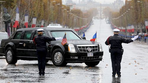 President Donald Trump's motorcade turns onto the Champs Elysees in Paris, France.