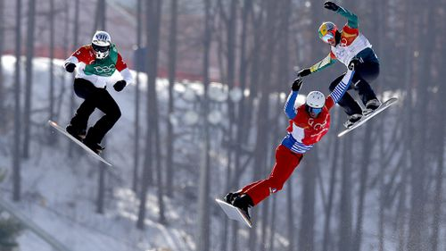 Australian snowboarder Jarryd Hughes was up against some tough opposition when he raced in the final of the snowboard cross today at the Pyeongchang Winter Olympics (AAP).