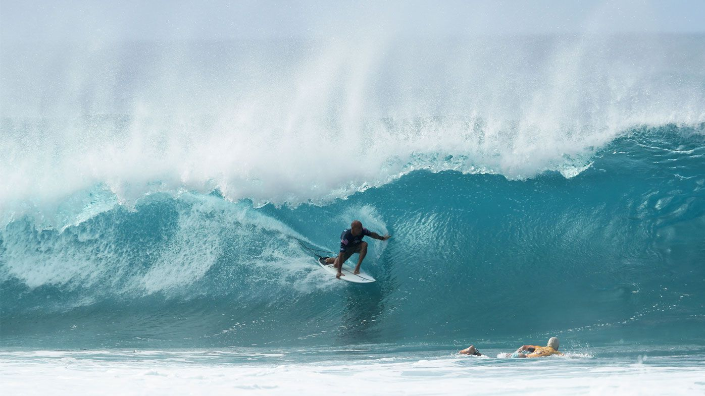 Kelly Slater of the United States surfs during the Billabong Pipe Masters