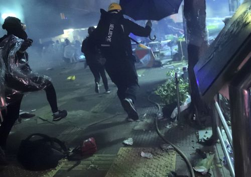 Police had fired repeated barrages of tear gas and water cannon at protesters outside the campus since before midnight.