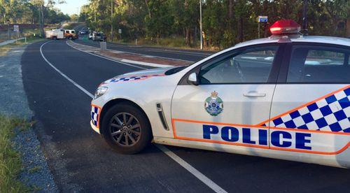 Police are investigating the crash scene at Kurwonbah. (9NEWS / Howie Bennett)