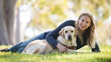 Liz Wheeler and her guide dog Poppi.