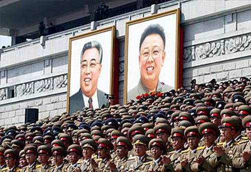 Portraits of Kim Il-sung and Kim Jong-il at parade (Getty)
