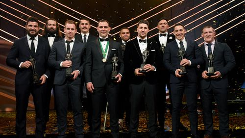 Members of the NRL team of the year pose for a photograph at the Dally M Awards. (AAP)