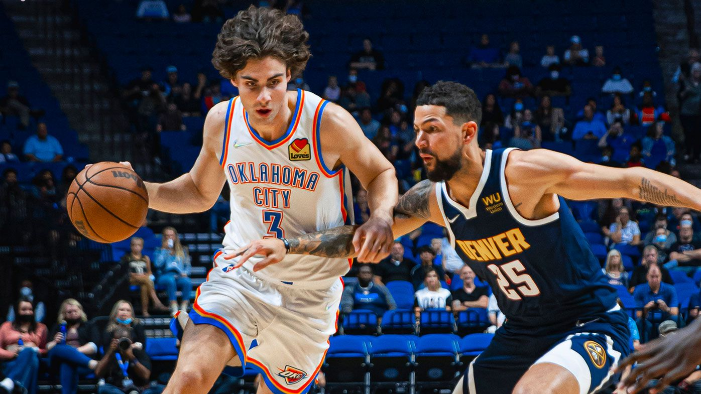Josh Giddey #3 of the Oklahoma City Thunder drives to the basket against the Denver Nuggets during a preseason game