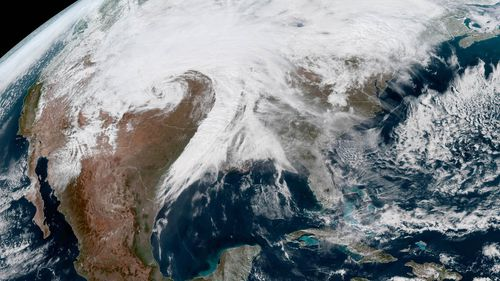 """A handout picture made available by the National Oceanic and Atmospheric Administration (NOAA) winter storm Ulmer becoming a """"bomb cyclone"""" over the central US."""