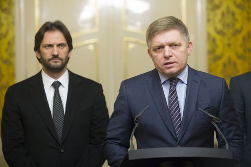 Slovak Prime Minister Robert Fico, right, gives a media statement, with Minister of Interior Robert Kalinak, left, after a silent protest march in memory of murdered journalist Jan Kuciak and his girlfriend Martina Kusnirova in Bratislava, Slovakia on Wednesday, Feb. 28, 2018. Investigative journalist Kuciak was shot dead in Slovakia last week while working on a story about the activities of Italian mafia in Slovakia and their alleged links to people close to Prime Minister Robert Fico.(AP Photo/Bundas Engler)