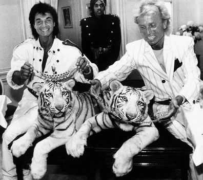 Las Vegas magicians Roy Horn, left, and Siegfried Fischbacher pose in New York, with their rare white tigers, Neva, left, a female, and Vegas, a male, during a stop at Van Cleef & Arpels jewelry before their departure for Germany (Photo: June 1987)