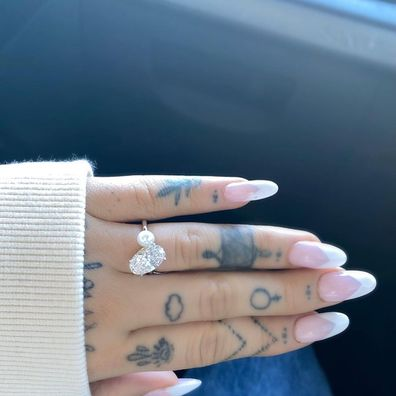 Ariana Grande flashed her giant engagement ring in December last year.
