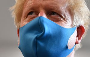 UK says it will make masks mandatory in shops following weeks of confusion