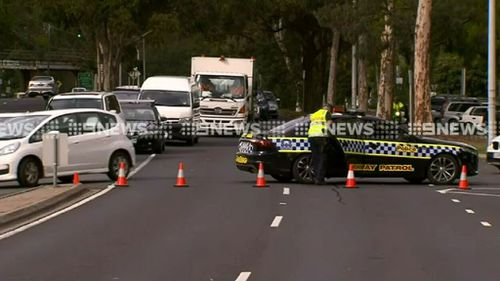 Motorcyclist has died in a crash involving a black Mercedes. (9NEWS)