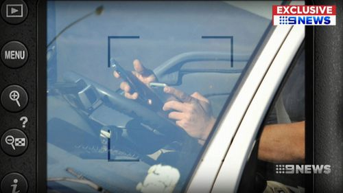 A truck driver has been caught using not one but two mobile phones while driving on Sydney's M5.