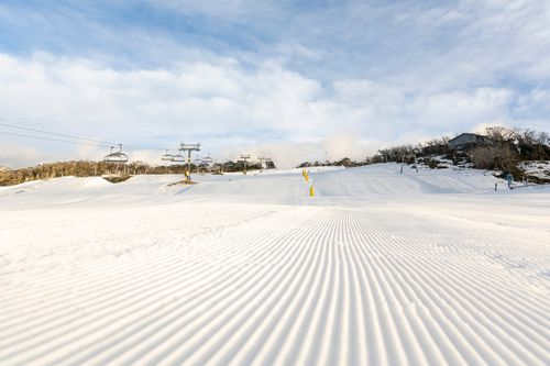 Groomed trails under the morning sun at Perisher, before the gates were opened.
