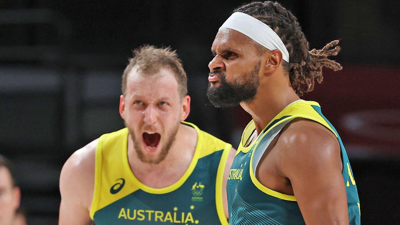Patty Mills #5 and Joe Ingles #7 of Team Australia react against Team Slovenia