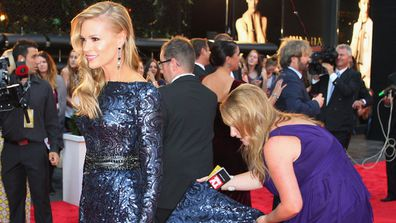 Sonia Kruger being helped with her dress at the Logies in 2013.