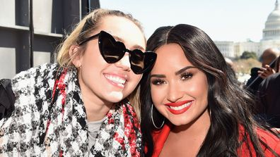 Miley Cyrus and Demi Lovato attend March For Our Lives on March 24, 2018 in Washington, DC.