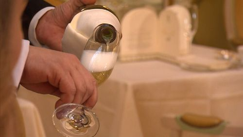 Champagne glasses - and any stemmed glass - must be held by the stem.