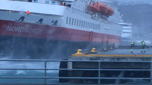 The cruise ship nearly colliding with the pier.