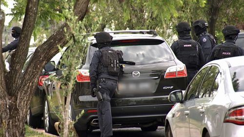 Anti-terrorism police during the raid on the western Sydney property. (Photo: AFP).