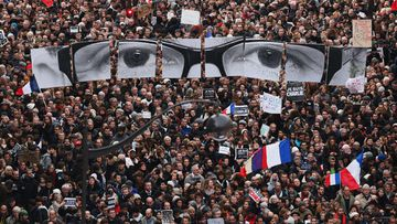 "More than a million people have flooded Paris in an unprecedented rally against terrorism, led by dozens of world leaders walking arm in arm as cries of ""Freedom"" and ""Charlie"" rang out.(Getty Images)"