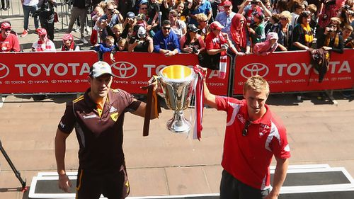 There can only be one: Swans favoured to beat Hawthorn in AFL grand final