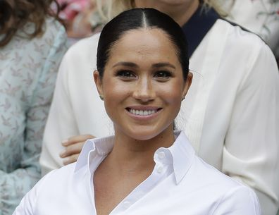 FILE - In this July 13, 2019 file photo Meghan, Duchess of Sussex smiles while sitting in the Royal Box on Centre Court to watch the women's singles final match between Serena Williams, of the United States, and Romania's Simona Halep on at the Wimbledon Tennis Championships in London. A British judge ruled Thursday Feb. 11, 2021, that a newspaper invaded Duchess of Sussex's privacy by publishing personal letter to her estranged father. (AP Photo/Ben Curtis, File)