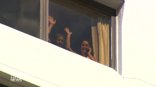 Danny Hodgson's parents Peter and Nicola wave from their Perth hotel room.