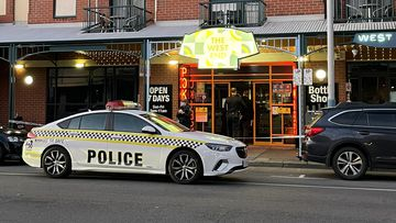 Police at the scene of a Hindley Street hotel in Adelaide.