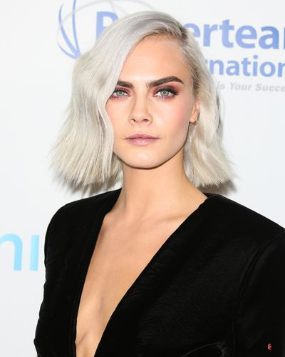 White hot and white blonde. Cara debuted her new 'lob' in April 2017.