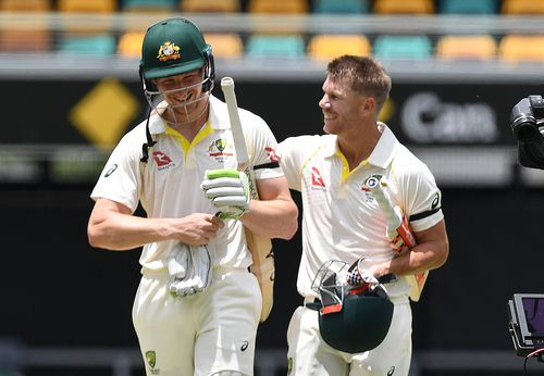 David Warner pats Bancroft on the back as they walk off after securing victory in the first Test at the Gabba. Picture: AAP