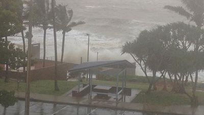 Waves now breaking over Yeppoon seawalls, 2.5m surge expected. (Twitter: Stefan Armbruster)